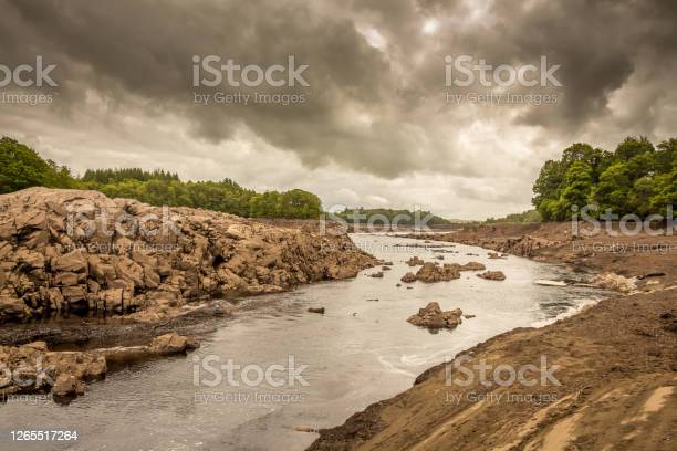 Photo of The Water of Ken river in the drained or dewatered Earlstoun Dam and Loch