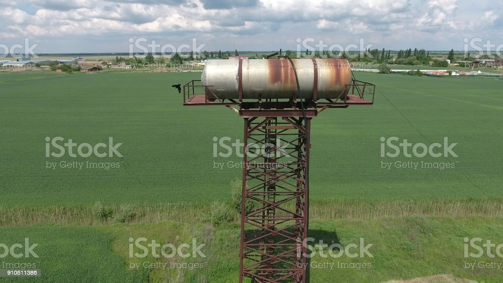 The water tower. An old rustic communal communication. The water tower stock photo