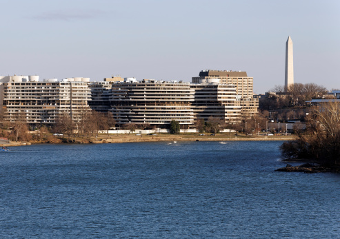 Washington, DC, USA – February 20, 2013: The Watergate Complex as seen from across the Potomac River. The Watergate complex is a group of five buildings in the Foggy Bottom neighborhood of Washington, DC.
