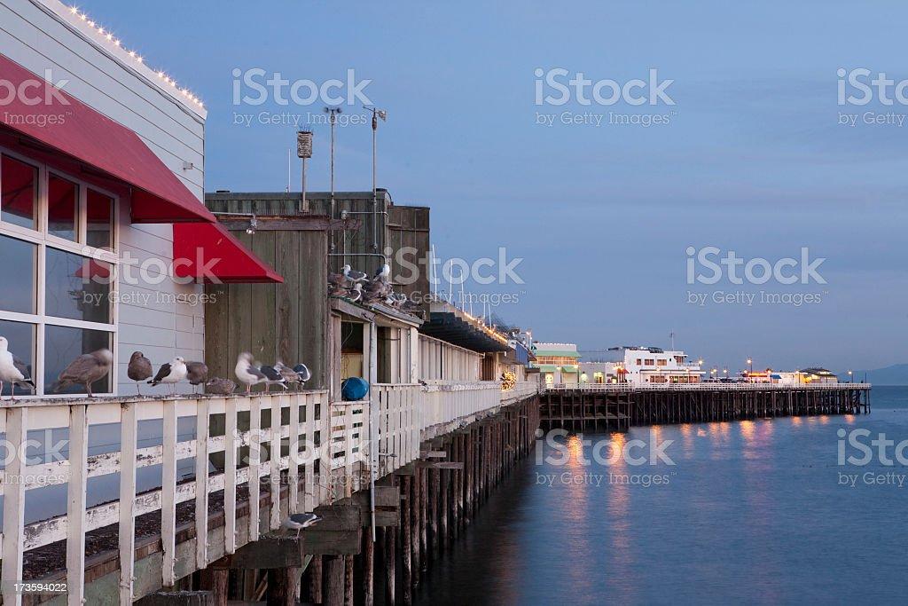 The waterside Santa Cruz boardwalk at dusk stock photo