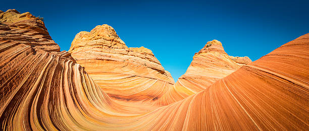 The Wave iconic sandstone strata deep in Arizona desert wilderness stock photo