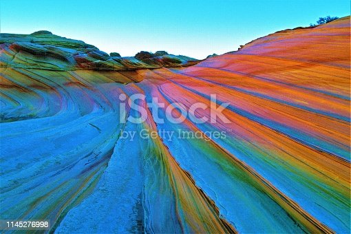 The Wave.  After rain the water and quartz in sandstone together bend light like an opal gemstone.  Creating the colors of the rainbow or prism.  I call it a