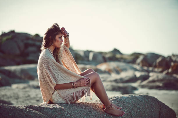The waves are music to her Shot of an attractive young woman spending a day at the beach romani people stock pictures, royalty-free photos & images