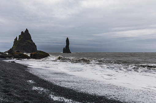 The Waves Hitting The Beach At Black Sand Beach Or Reynisfjara Stock Photo - Download Image Now