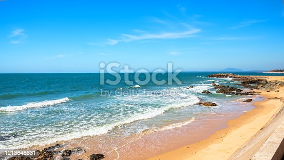 The waves hitting the shore or beautiful rocks create peaceful scenery in the bay of Vietnam