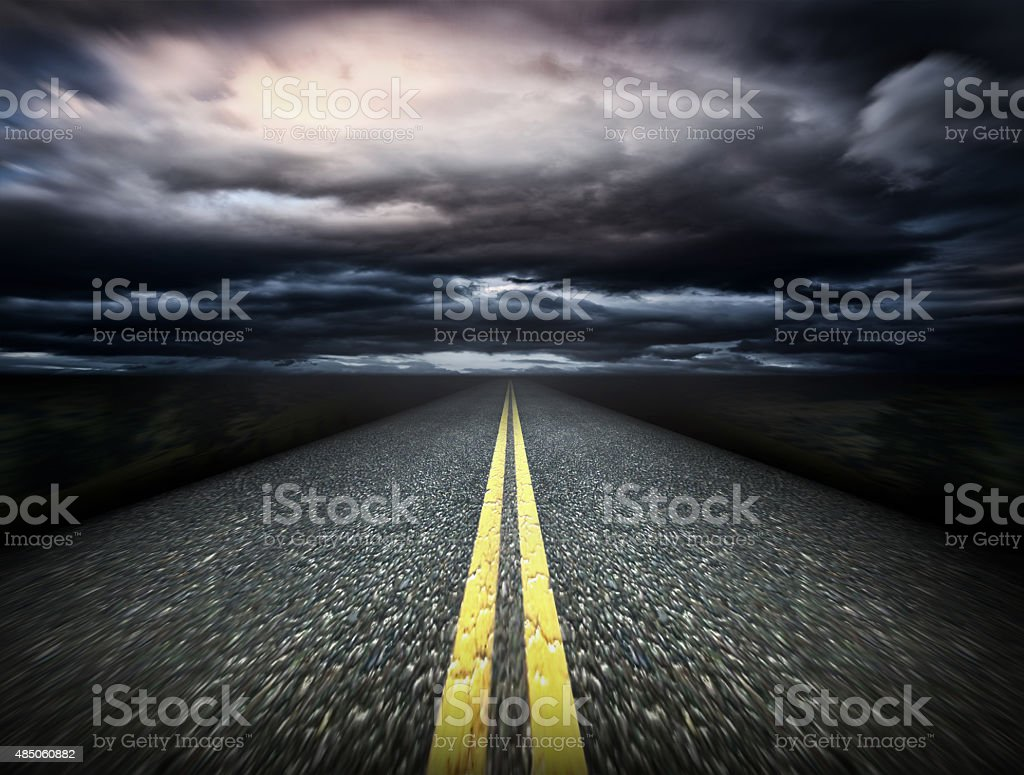 The way and dark clouds stock photo