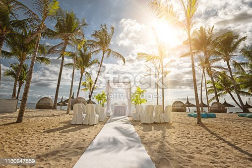 The island Mauritius is a popular destination to celebrate a romantic wedding under palm trees on the white beach. Mauritius, an island state in the Indian Ocean, is also known for its beaches, lagoons and reefs.