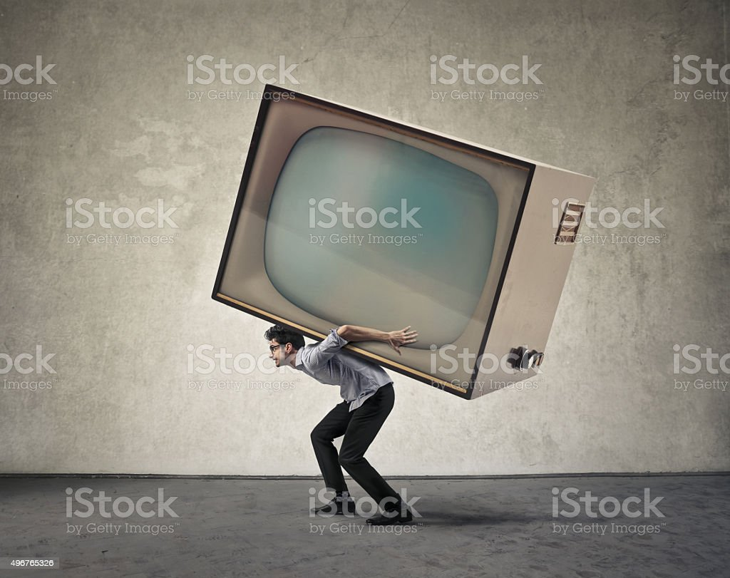 The weight of the media stock photo
