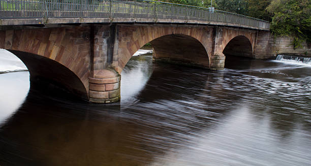 the weir the weir at belper river gardens with a long exposure abjure stock pictures, royalty-free photos & images