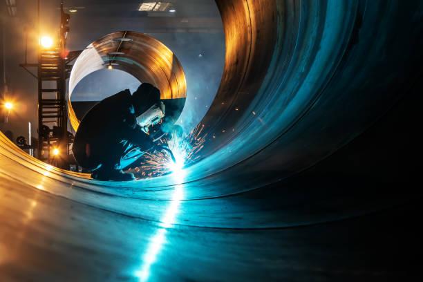 The welder is welding steel plates stock photo