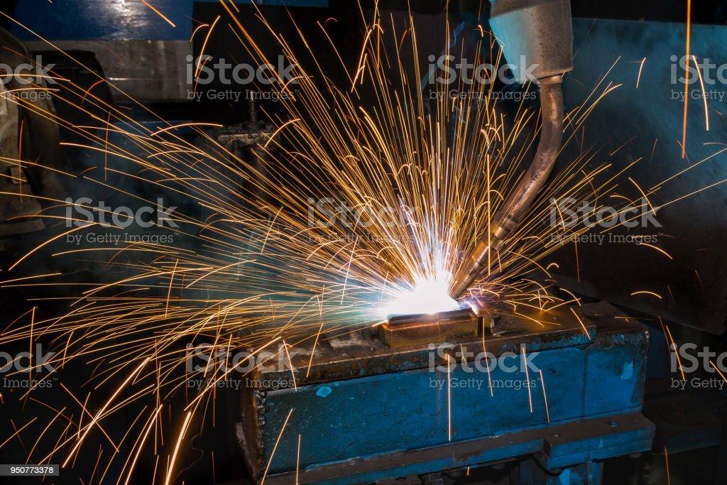 Close up torch welding of robot welding in automotive industrial