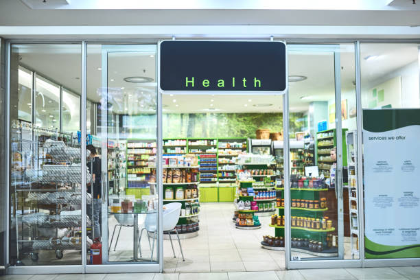 The wellness store welcomes you Shot of the entrance to a health store entrance stock pictures, royalty-free photos & images