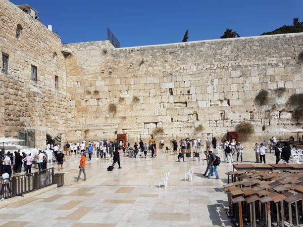 The Western Wall , Jerusalem, Israel Jerusalem, Israel: October 04, 2018: The picture shows People, visitors and worshipers At The Western Wall , Jerusalem, Israel.Many Bar Mitzvot are performed on the Western Wall on Thursdays  Citizens and tourists travel in the holy place.The Western Wall is a holy place for various religions and the place of prayer for many Jews. jerusalem old city stock pictures, royalty-free photos & images