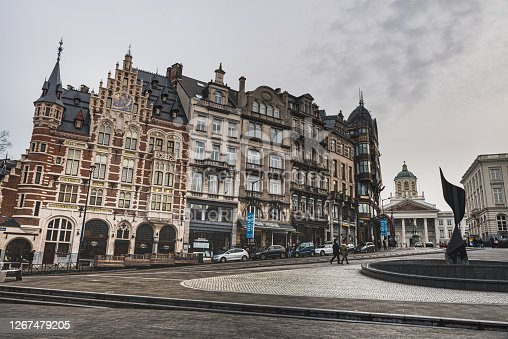 Brussels, Belgium - January 21, 2018  The Whirling Ear is a monument created by Alexander Calder in 1958. A row of typical Belgian neoclassical houses provides an architectural glimpse of Bruxelles