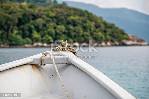 The white beak of a small tourist boat