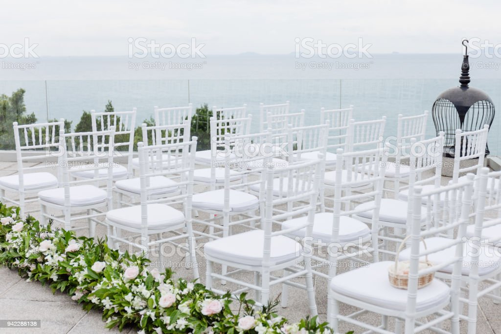 White Chairs At A Wedding Indoor Stock Photo: The White Chiavari Chairs Setup For Modern Beach Wedding