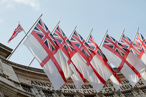 Flotilla of White Ensign flags on Admiralty Arch London stock photo
