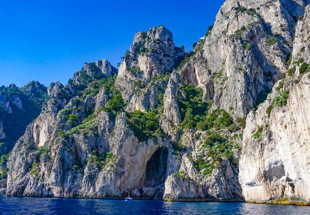The White Grotto of the island of Capri, Italy.  Coastal Rocks on the Mediterranean Sea at Capri Island from a motorboat tour. stock photo