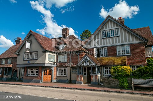 The White Hart in Brasted near Westerham in England. A coat of arms for the pub is in the foreground.