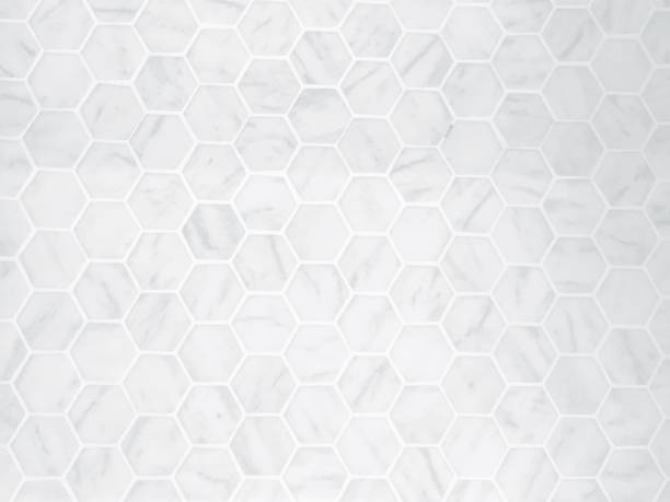 the white hexagon marble tile texture background - tile stock photos and pictures