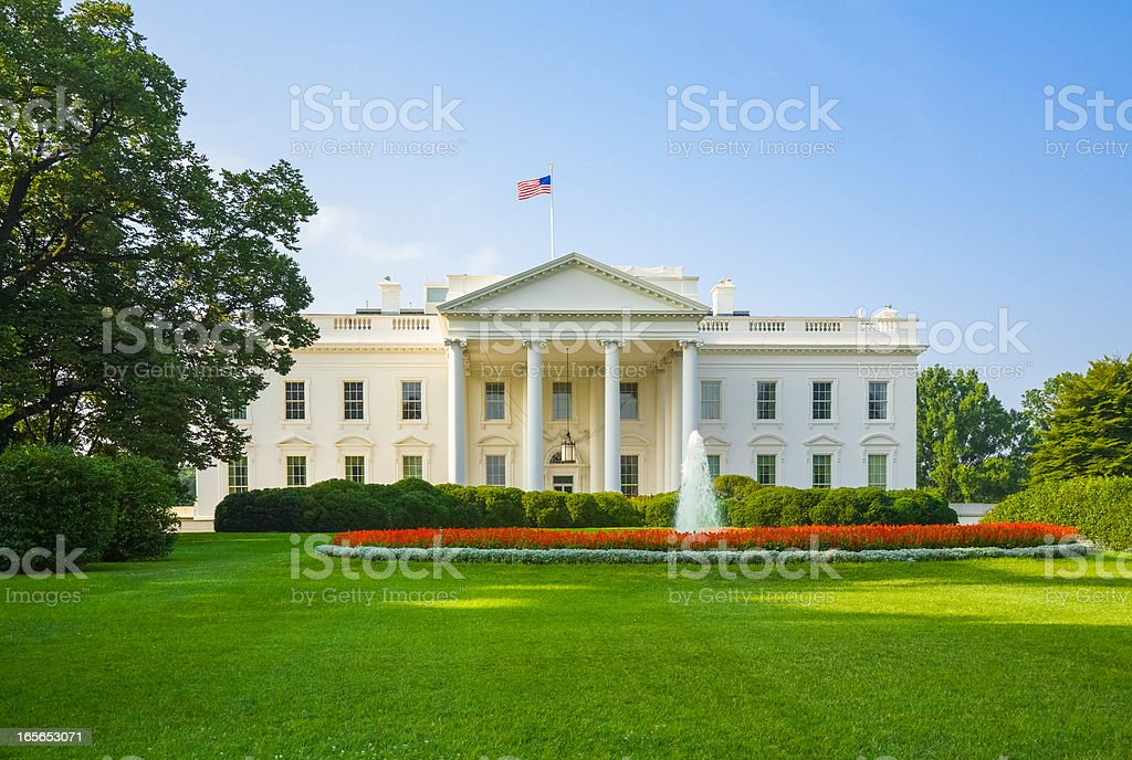 The White House, green lawn, blue sky, early morning light stock photo
