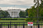 Photo of the White House in Washington, D.C. on a cloudy day with a \