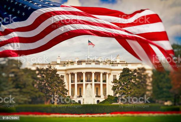 The white house with waving american flag picture id918426992?b=1&k=6&m=918426992&s=612x612&h=2a4oy9nlbyhuw pjuuag6amwyrnvtld tq32tfwo2nm=