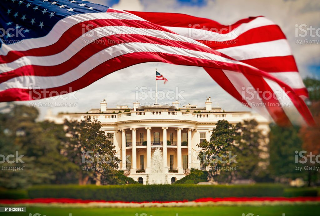 The White House with waving American flag stock photo