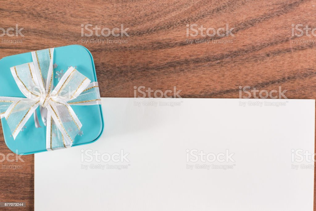 The white letter and a green gift box stock photo