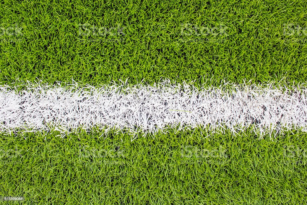 The white Line marking on the artificial green grass football