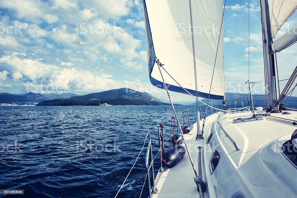The white sails of yachts on the background sea and stock photo