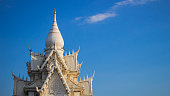 The white thai temple roof on blue sky background