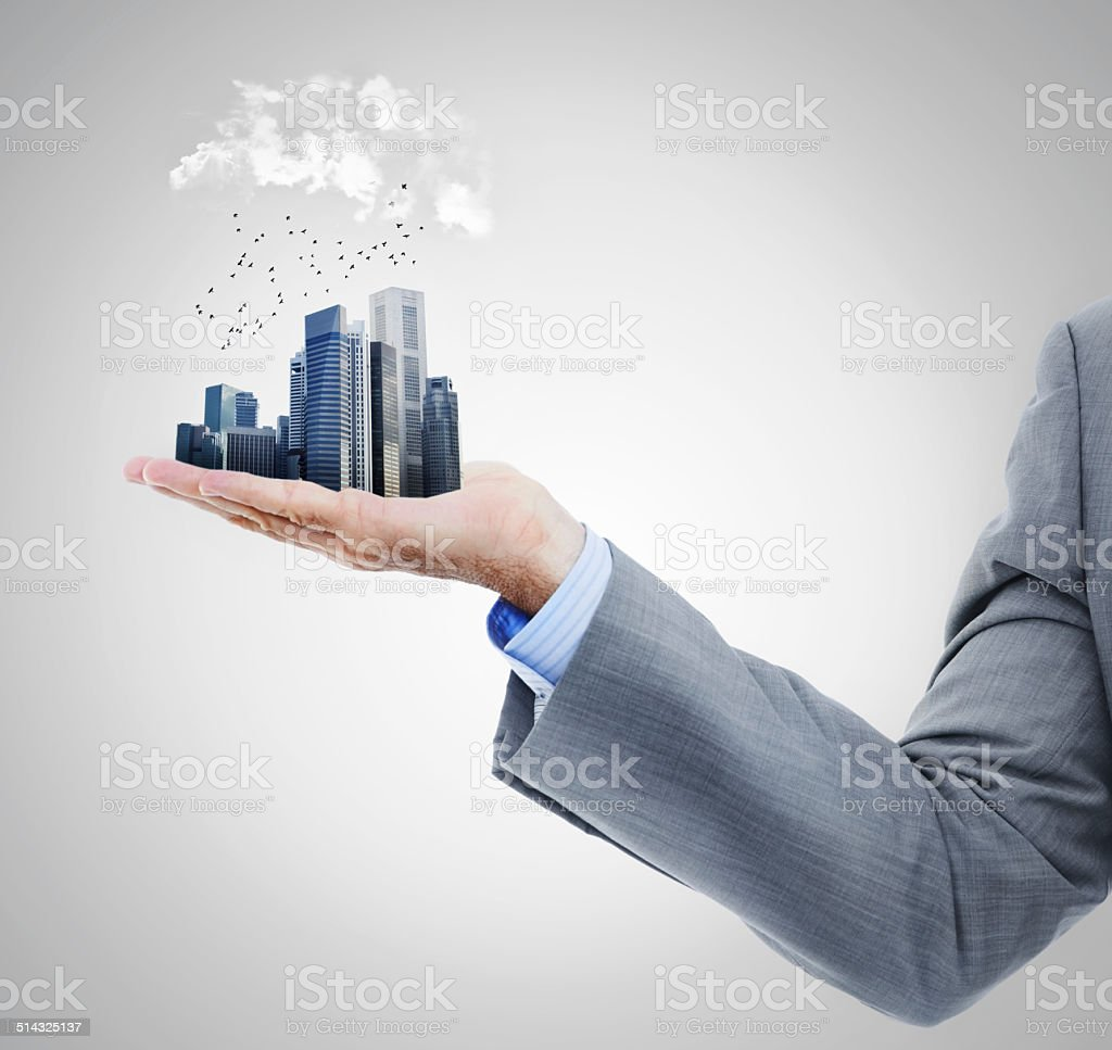 The whole city in the palm of your hand stock photo
