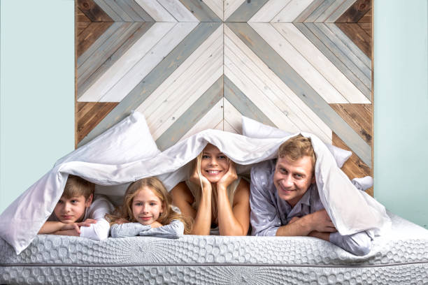 The whole family in the morning in bed stock photo