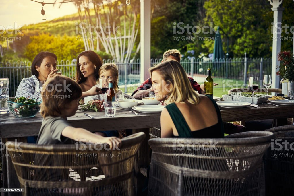 The whole family is getting together for lunch stock photo