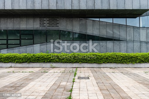 520881658 istock photo The wide and unoccupied marble square in front of the city's modern buildings 1239742136