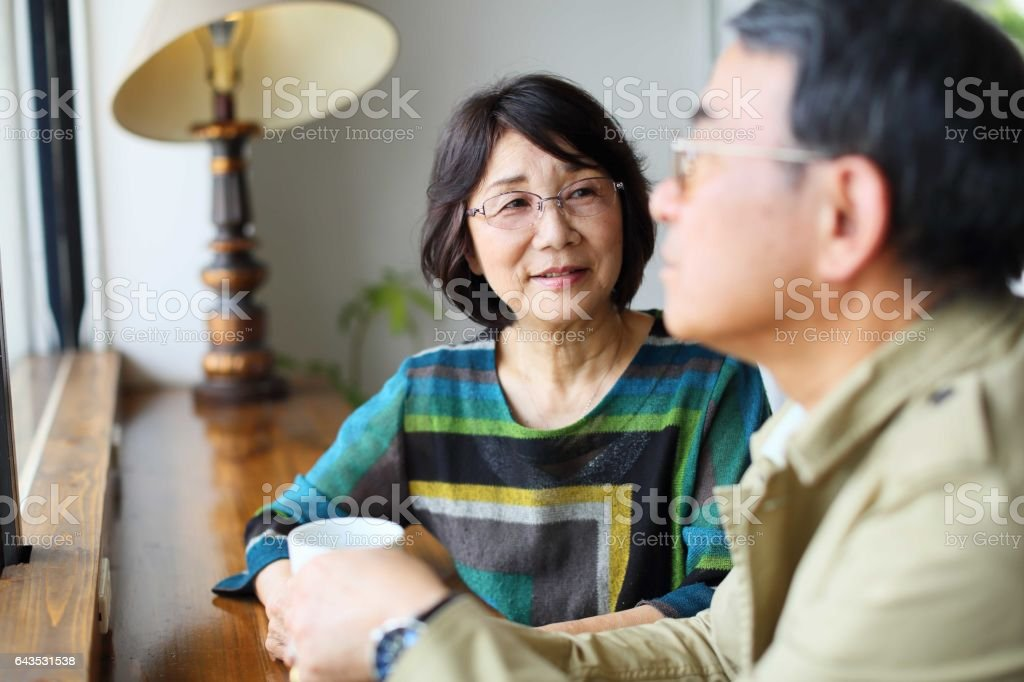 The wife who looks at the husband of illness stock photo
