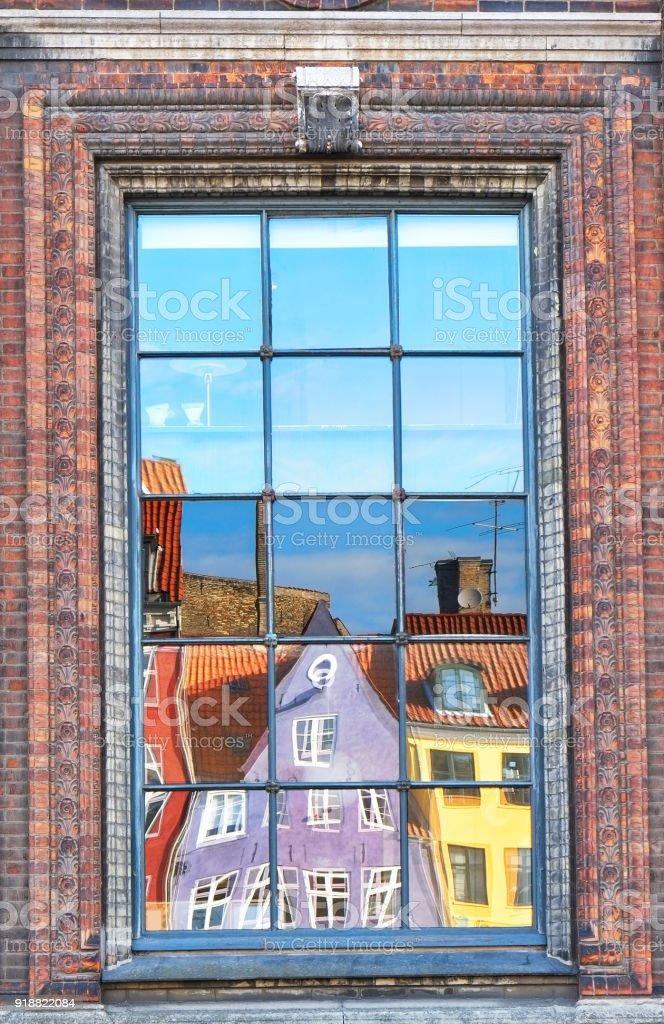The window reflection of Nyhavn townhouses in Copenhagen. stock photo