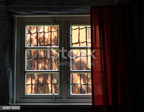 The Window With Curtain Of An Old Farmhouse Inside Stock Photo