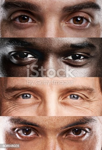 A cropped view of four different nationalities of men's eyes