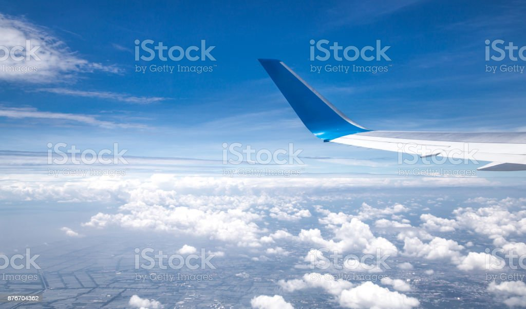the wing of the plane on sky background stock photo