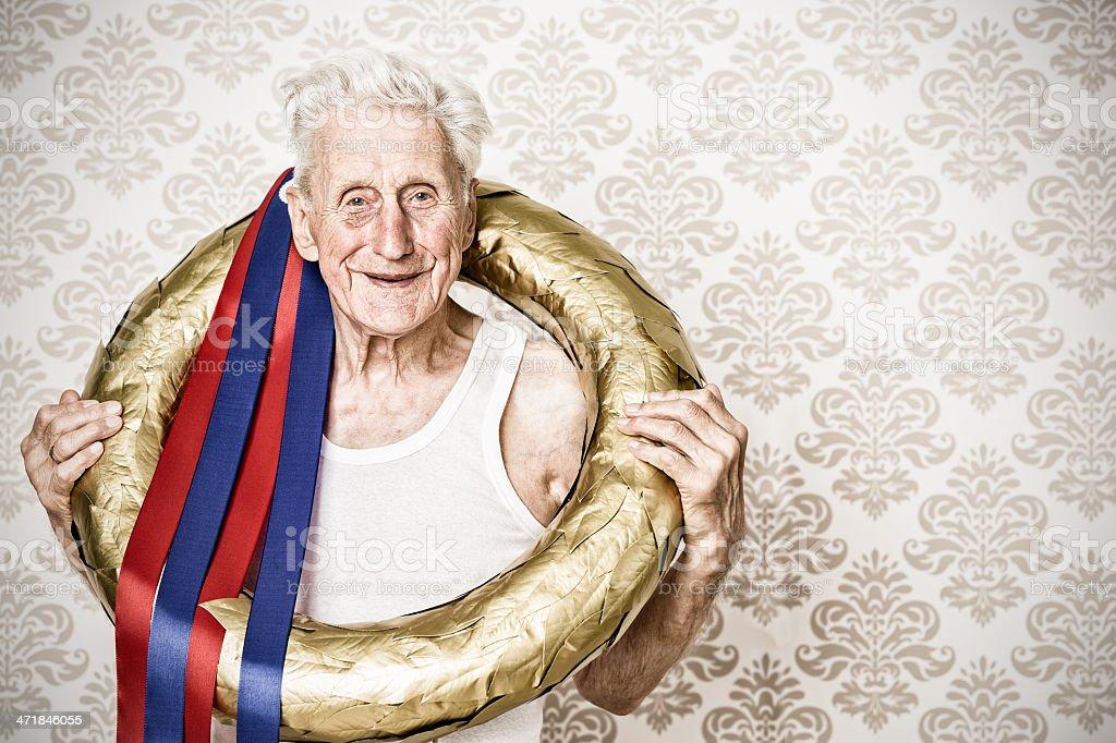 The Winner - senior man with golden laurel wreath stock photo