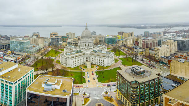 The Wisconsin State Capital at Madison The State Capital in Madison Wisconsin is an impressive architectural structure located in the center of the city along the lakeshore. madison wisconsin stock pictures, royalty-free photos & images