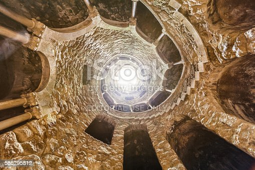 Sintra, Portugal - September 27, 2015: At the bottom of the spiral staircase in Quinta da Regaleira, Sintra, Portugal. The path of initiation.