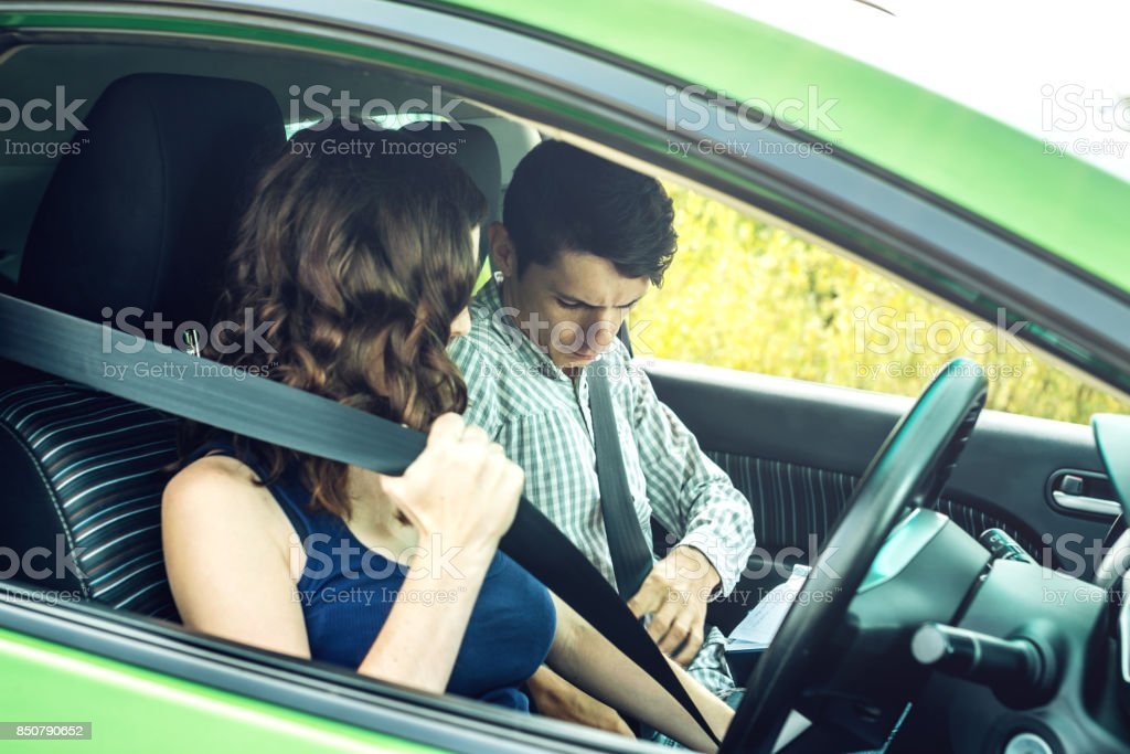 The woman and the man in the car wear a seat belt. Concept of road safety and observance of traffic rules stock photo