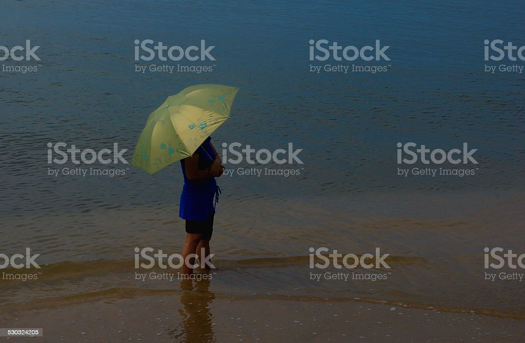 The woman at side of sea stock photo