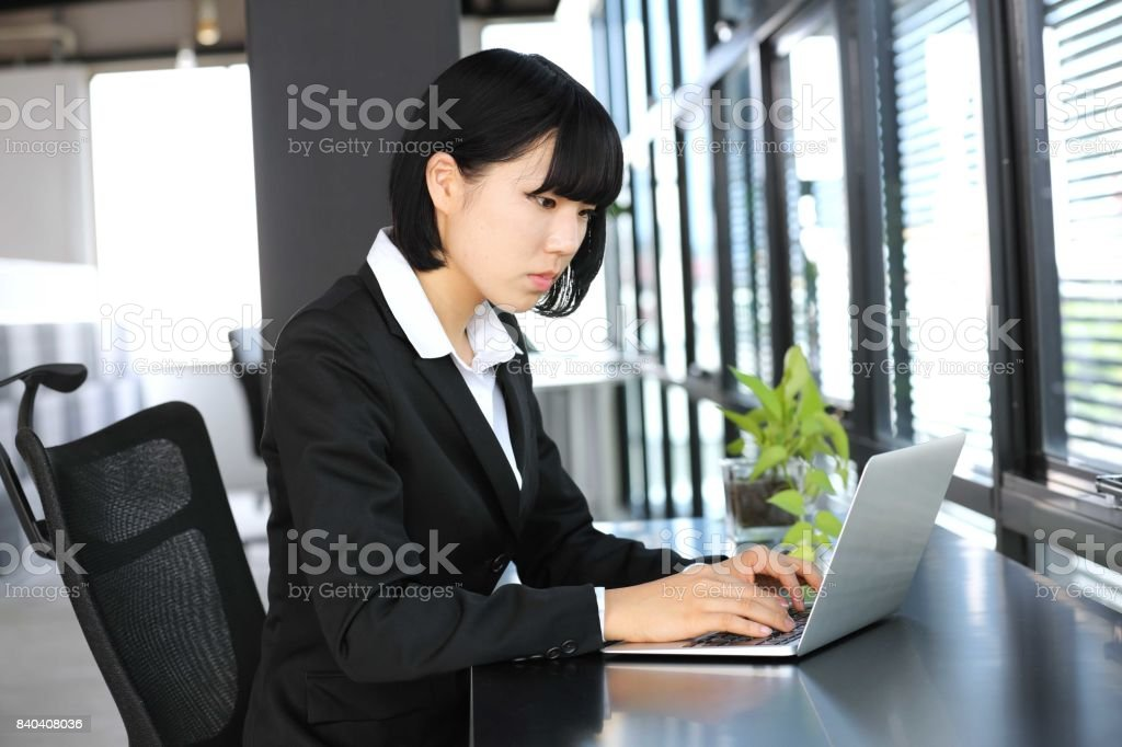 The woman employee who inputs a sentence into a PC stock photo