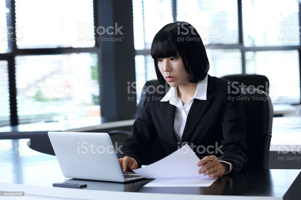 The woman employee who inputs the contents of documents into a PC stock photo