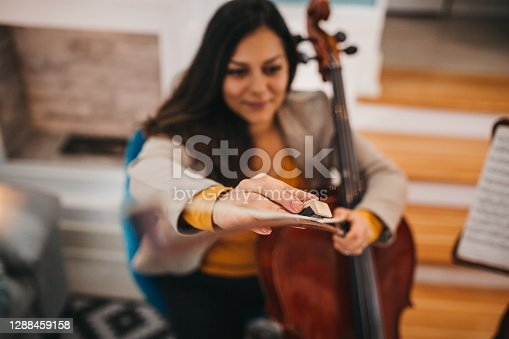 The woman enjoys the music and the headphones