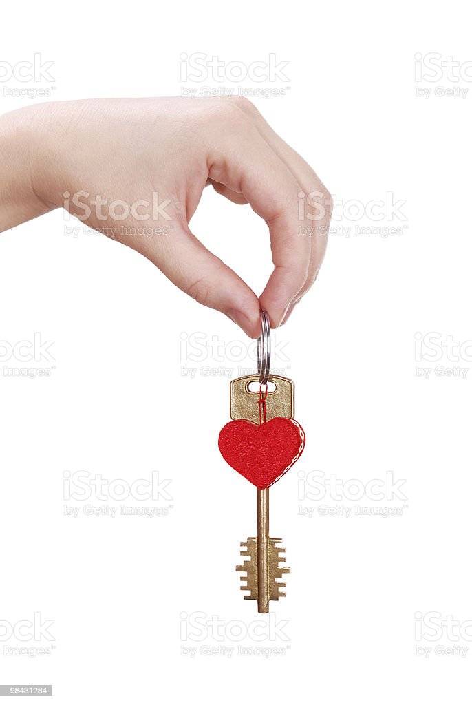 The woman hand holds a key to heart royalty-free stock photo
